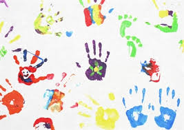 Painted children's hands on a white background